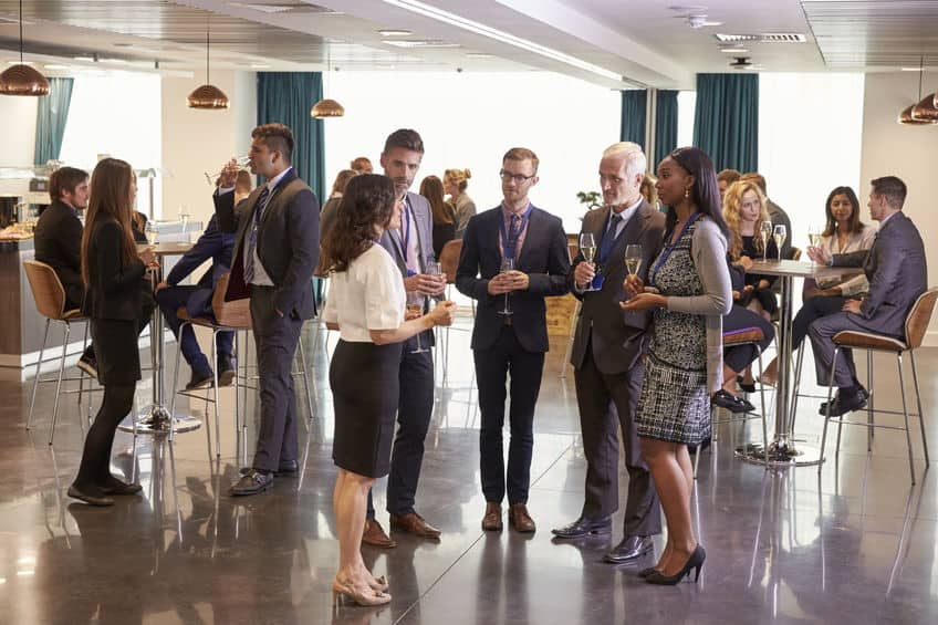 71258940 - delegates networking at conference drinks reception